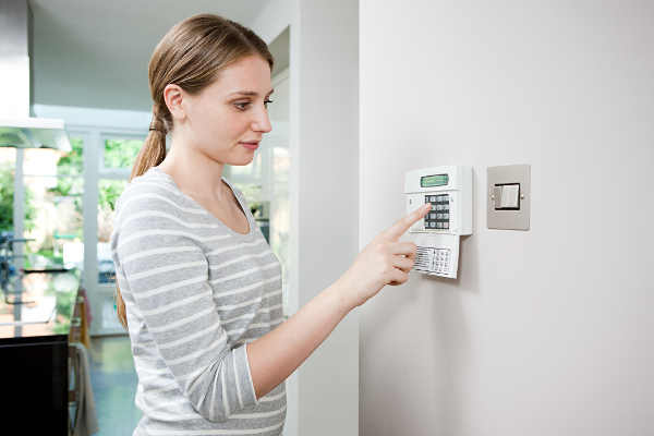 Commercial Alarm system keypad with woman